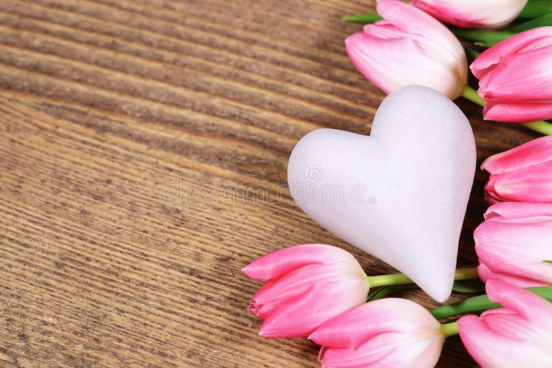 Pink tulips with heart, copy space stock photos