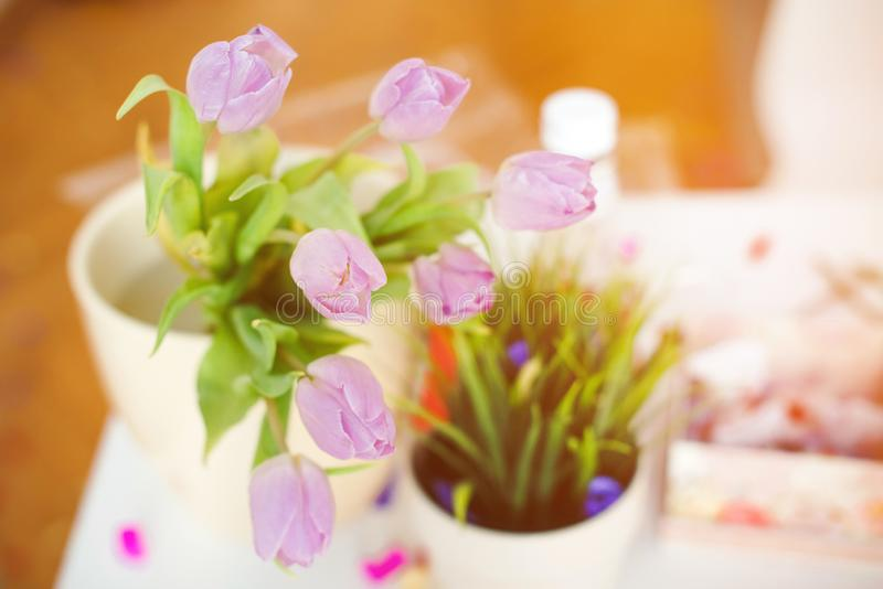 Pink tulips in a vase on a kitchen table. Good beginning of the day. Morning mood. Spring concept. Sunny spring morning with. Flowers stock photo