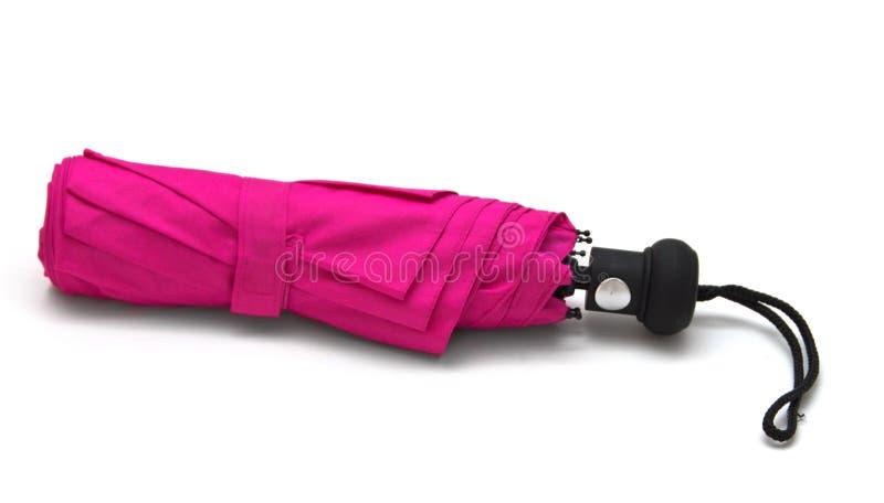 Pink umbrella. Isolated on white background stock photo