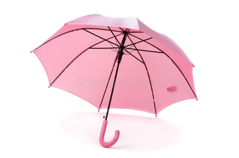 Pink umbrella. Child's pink umbrella over white royalty free stock photo