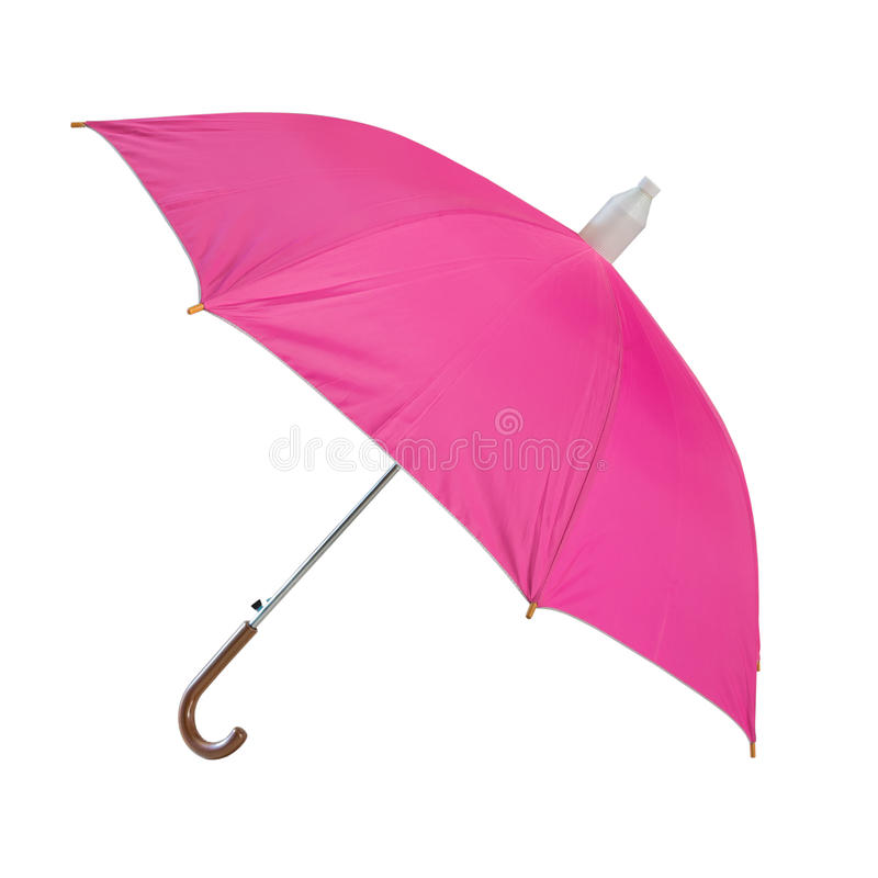 A pink umbrella. Isolated on white background royalty free stock photo