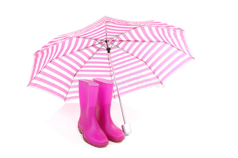 Pink umbrella and rain boots. Isolated on white background royalty free stock photography