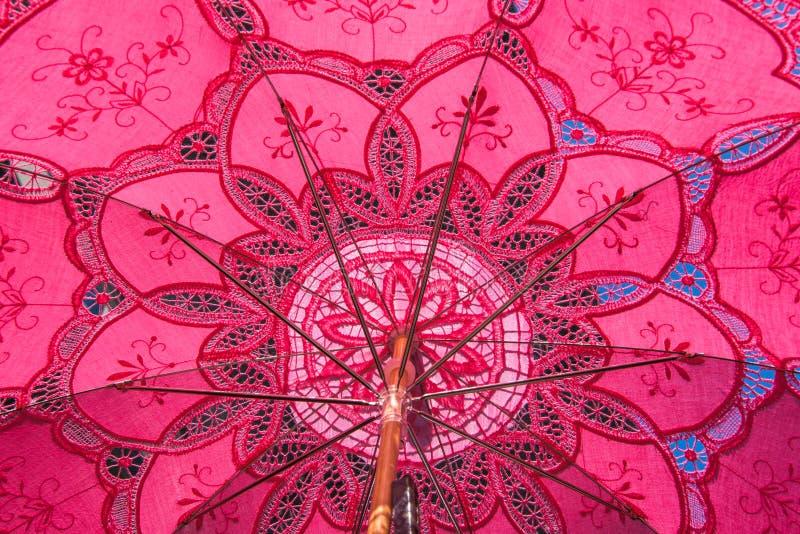 Pink dentelle umbrella fron Venise. Pink dentelle umbrella in Venice closeup detail background stock photos