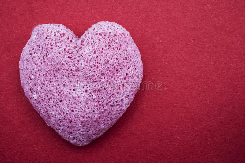 Pink Valentines heart with board to write, red background. Happy Valentines Day royalty free stock photo