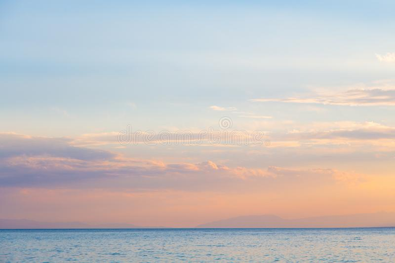 Pink vanilla heaven. Bright blue sky with gentle cumulus clouds. soft pastel colors stock image