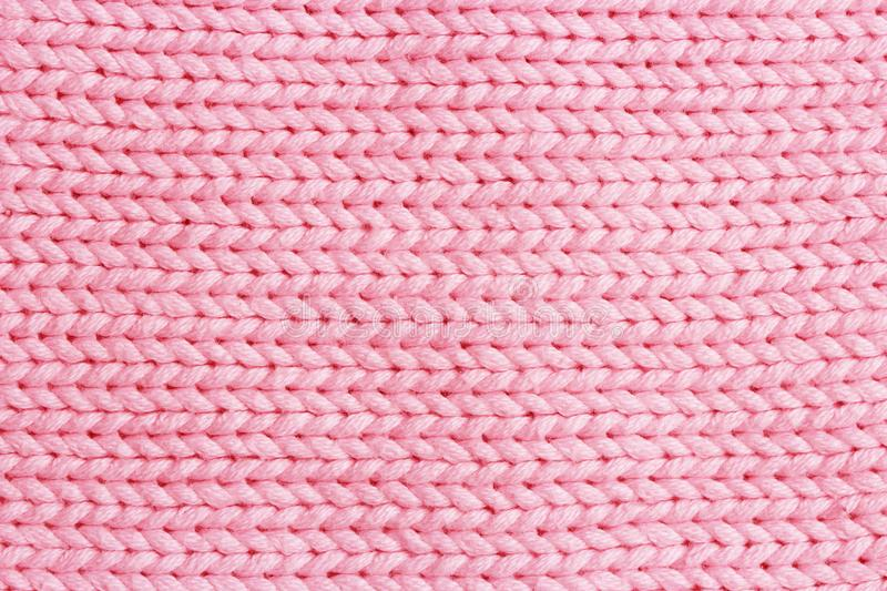 Pink vertical line knitting fabric texture background or knitted royalty free stock photo