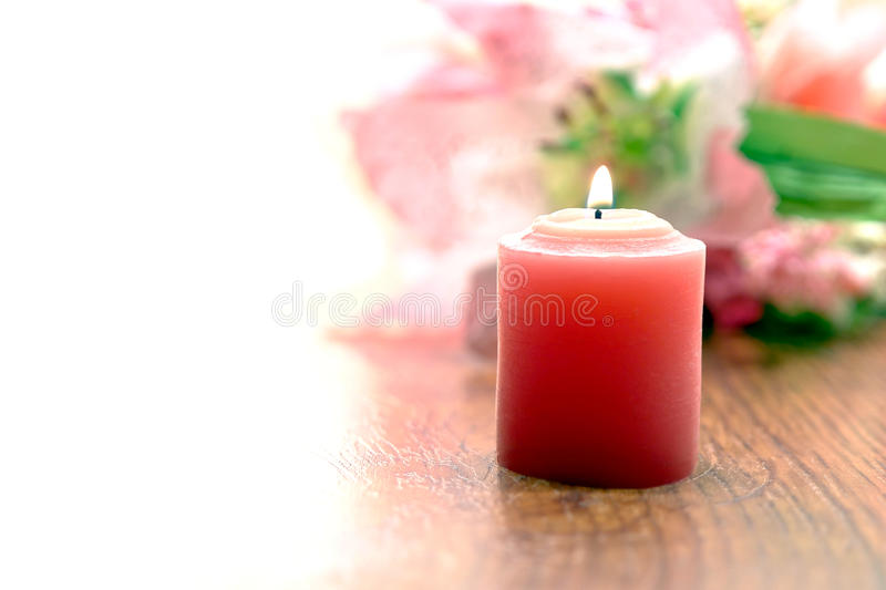 Pink Votive Candle and Flowers with White Space royalty free stock photos