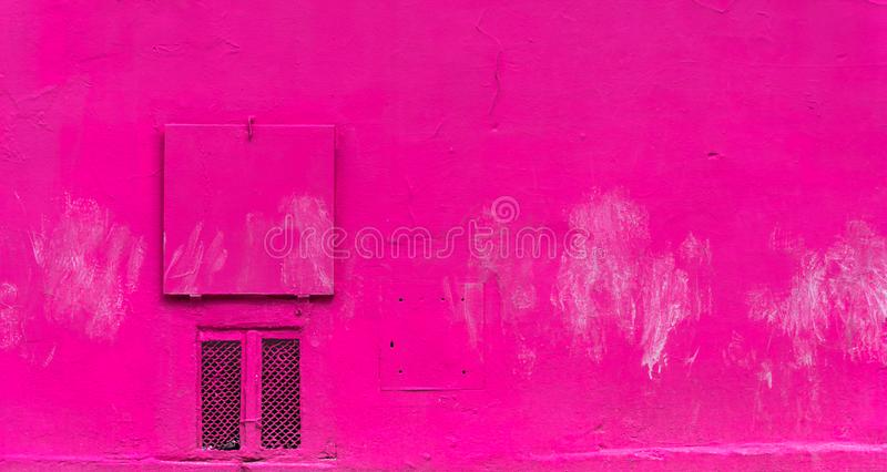 The pink wall and the small ventilation flap royalty free stock photo