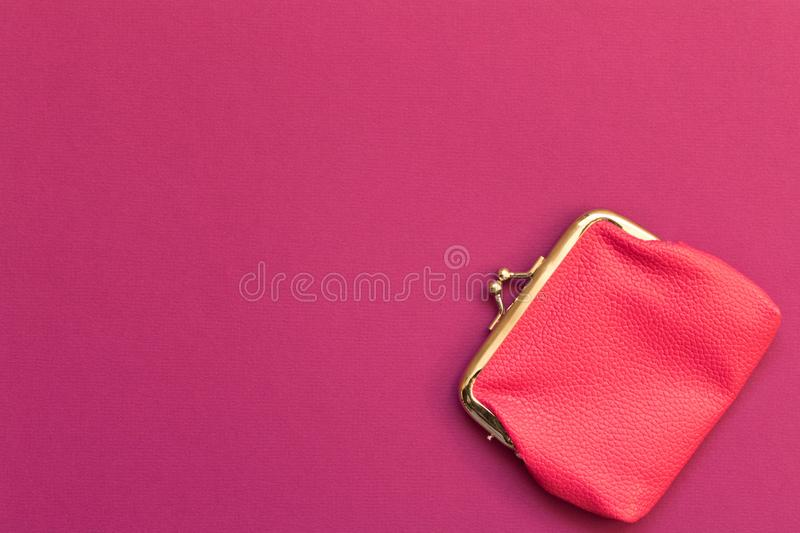 Pink wallet purple background . The concept of savings. Top view royalty free stock photography