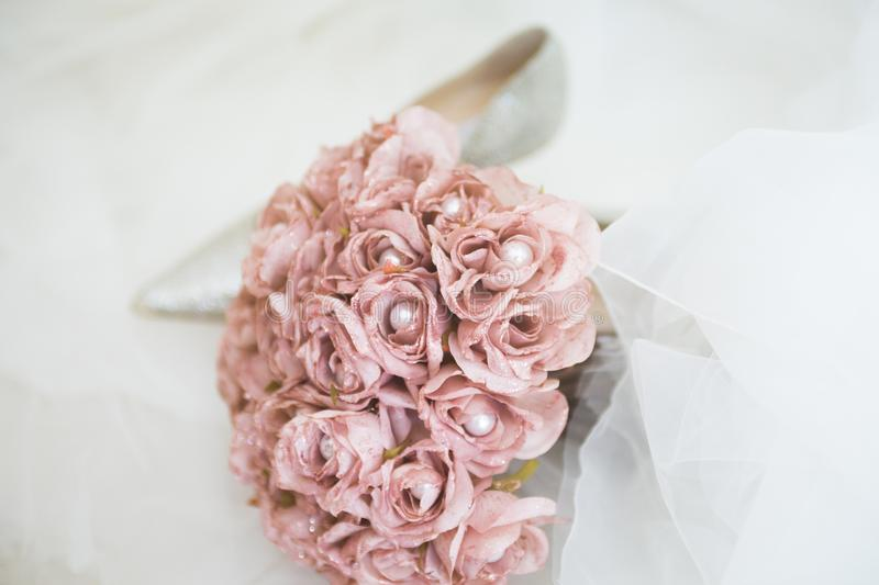 Pink wedding flowers and heels royalty free stock images