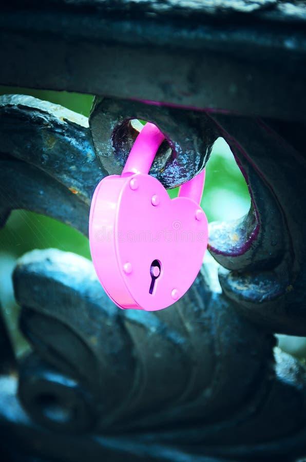Pink wedding iron lock. Close-up stock photos