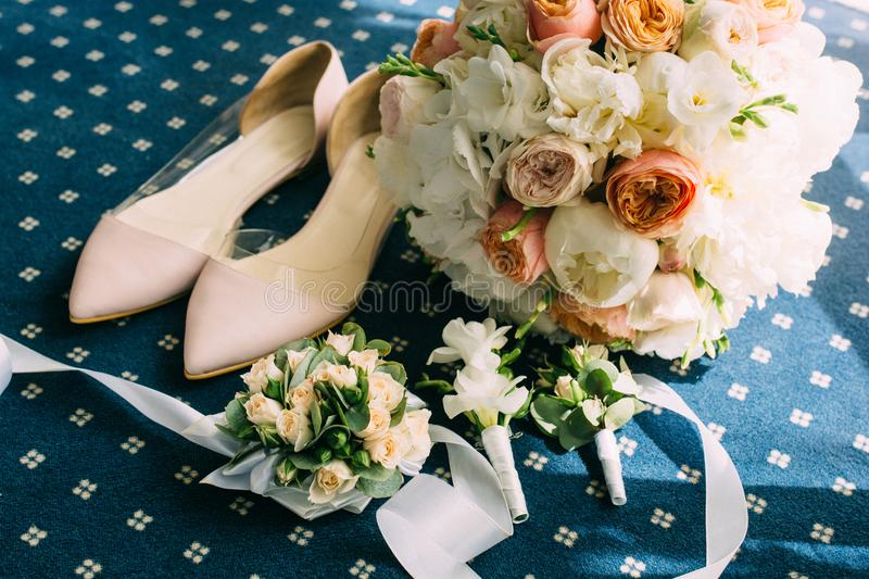 Pink wedding shoes with accessories royalty free stock image