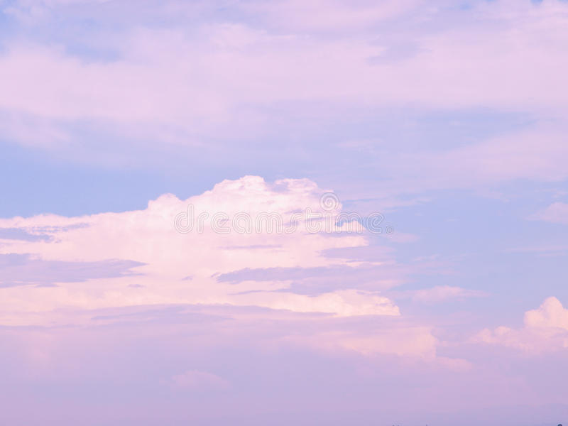 Pink and white clouds in blue sky stock image