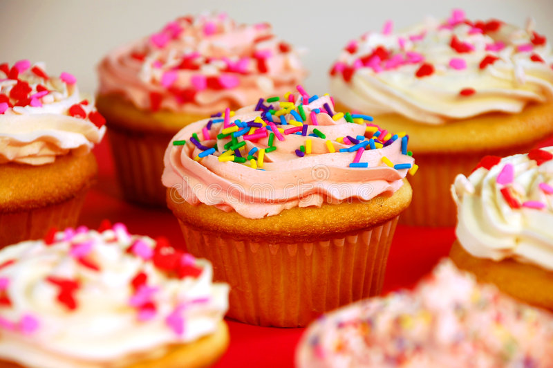 Pink and white cupcakes. Pink and white frosted cupcakes with sprinkles royalty free stock images
