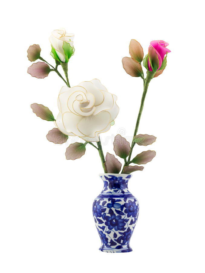 Pink and white nylon fabric flower in blue ceramic vase on isolate white background stock images