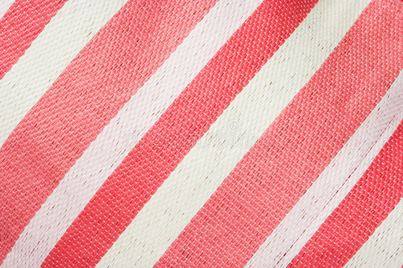 Pink and white stripped backgr. Diagonal pink and white stripes. The image has a woven texture royalty free stock photos