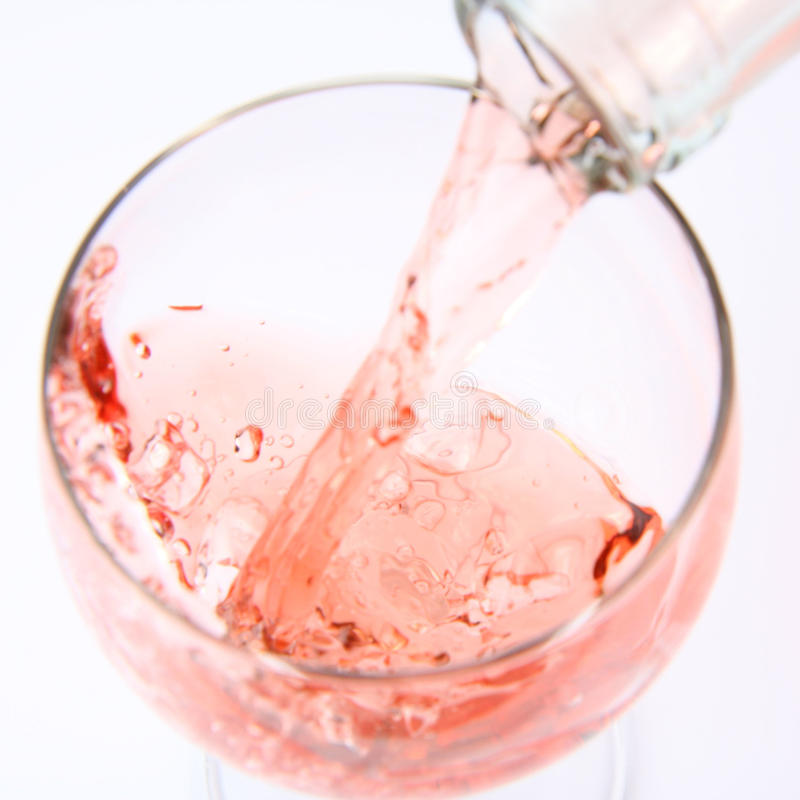 Download Pink wine being poured stock photo. Image of crystal - 14864102