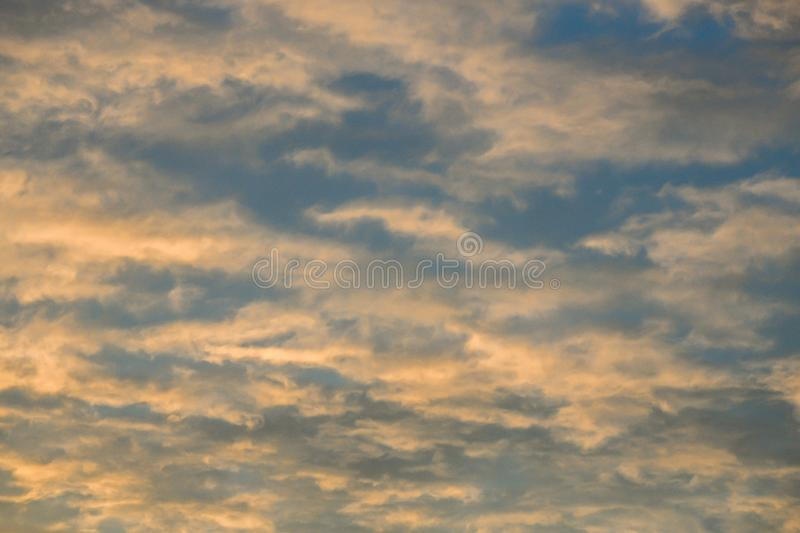 Pink wispy clouds at sunset stock photography