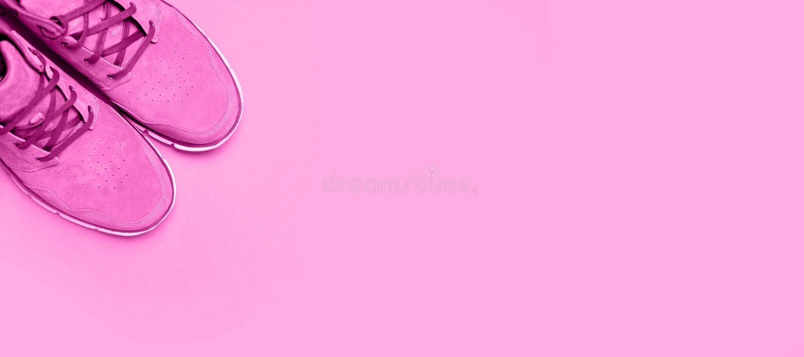 Pink Woman boots on pink background. Copyspace, flat lay. stock photo