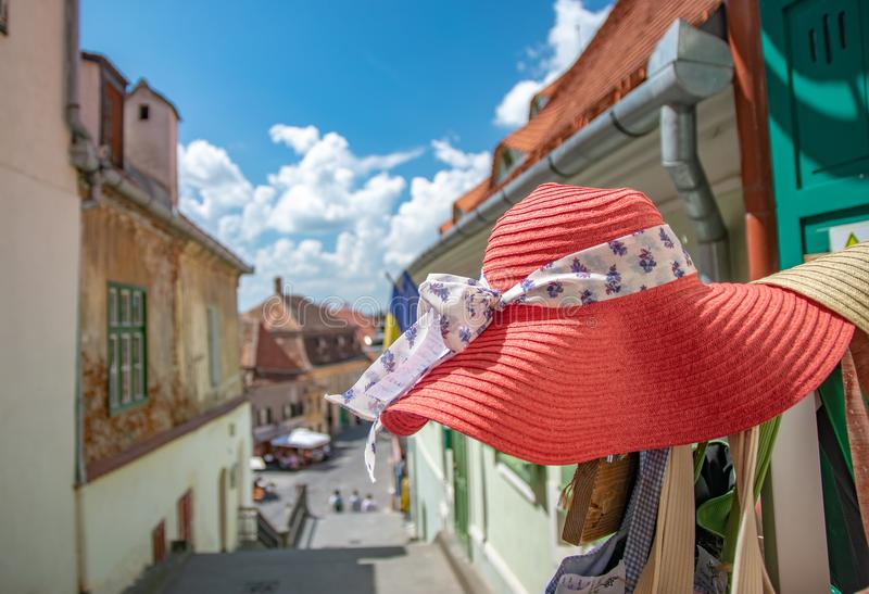 Pink women hat close-up on The Stairs Tower in a beautiful medieval town of Sibiu on a sunny summer day with blue sky, Sibiu, royalty free stock photo