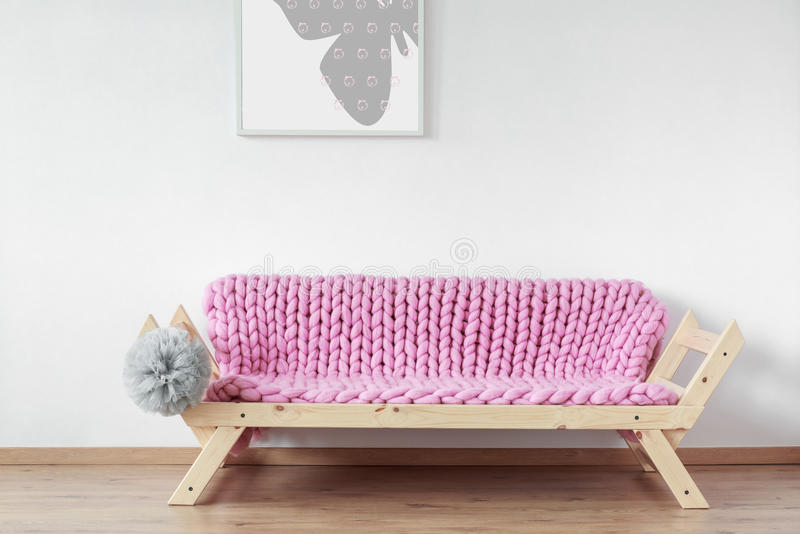 Pink wooden couch stock photography