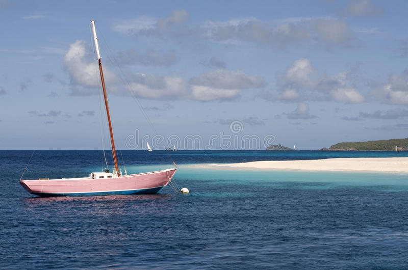 Pink Yacht - Palm Island View - Caribbean. royalty free stock photos