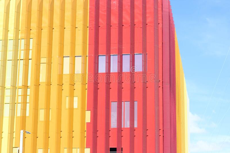 Pink and yellow building stock photos