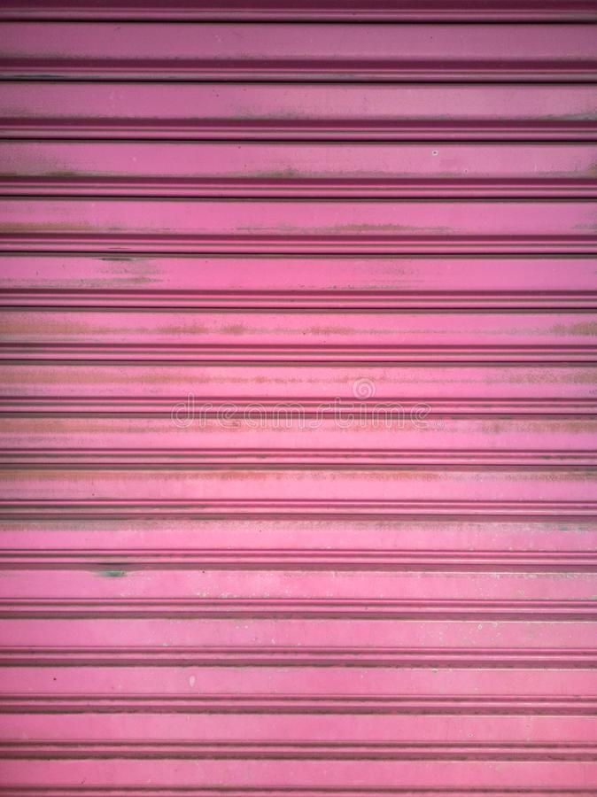 Pink zinc fence with stain background royalty free stock image
