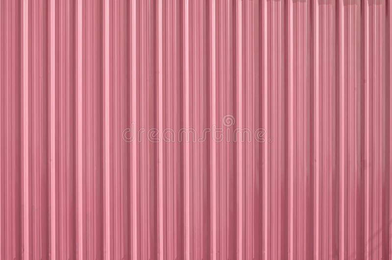 Pink zinc metal corrugated fence,metalsheet fence for background royalty free stock photo
