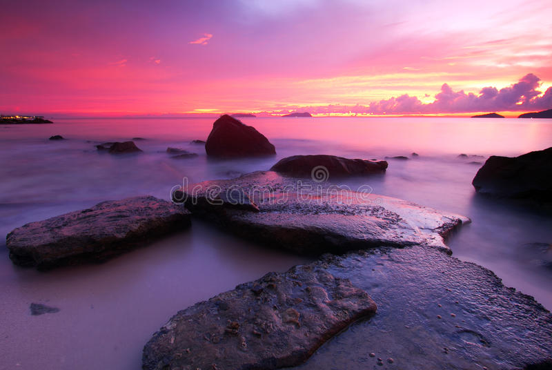 Pinky Sunset & The Rock At The Coast Royalty Free Stock Image