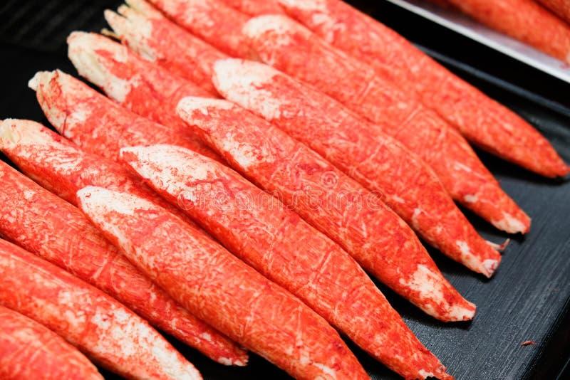 Pinnar Surimi för efterföljdkrabbakött arkivbild