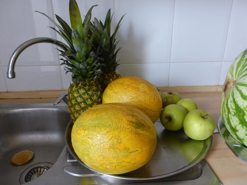 Pinneaple. Big fruit and little fruit for eating royalty free stock images