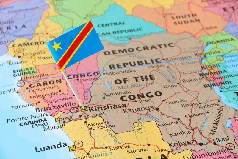 Pino da bandeira de the Democratic Republic of the Congo no mapa imagens de stock