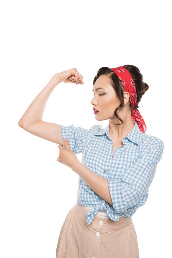 Pino forte acima da mulher que mostra os músculos fotos de stock royalty free