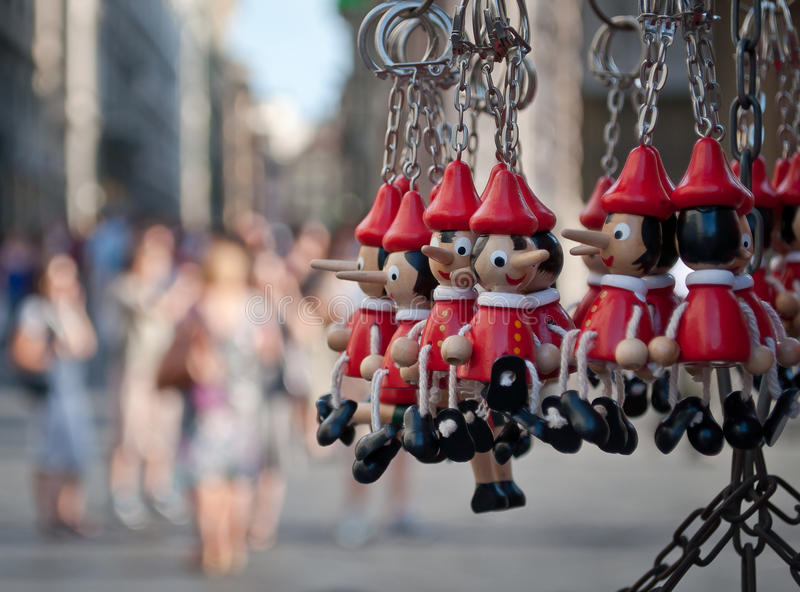 Pinocchio keychain. Is a fictional character and the main protagonist of the children's novel The Adventures of Pinocchio (1883), by the Italian writer Carlo royalty free stock photo