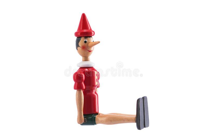 Pinocchio Toy Statue som isoleras på vit royaltyfria foton