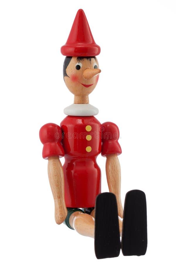 Pinocchio Toy Statue som isoleras på vit fotografering för bildbyråer