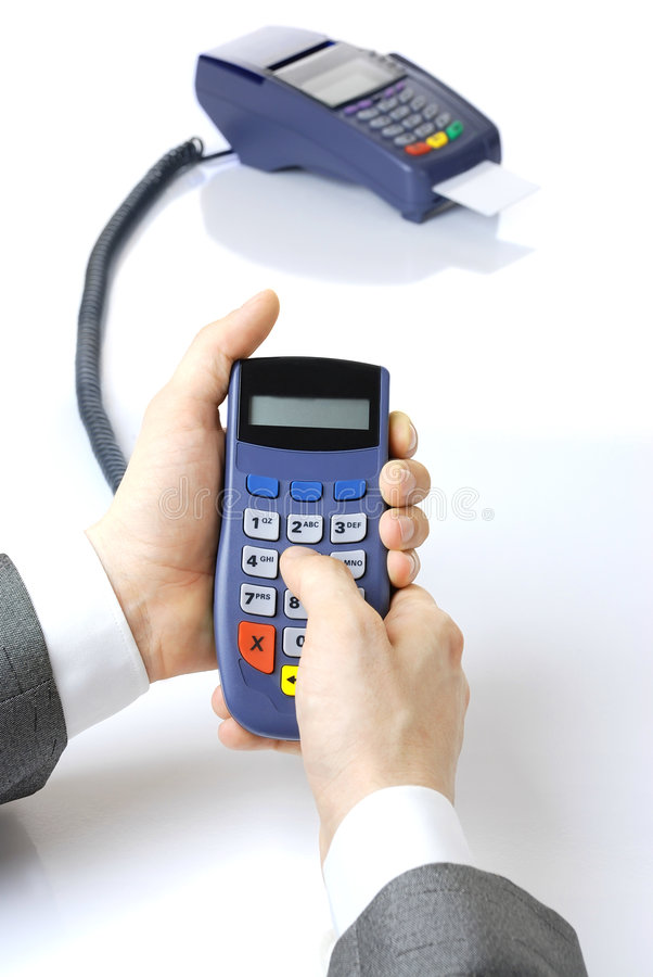 Pinpad in hands at the businessman. Pinpad and terminal with a card. Pinpad in hands at the businessman stock photo