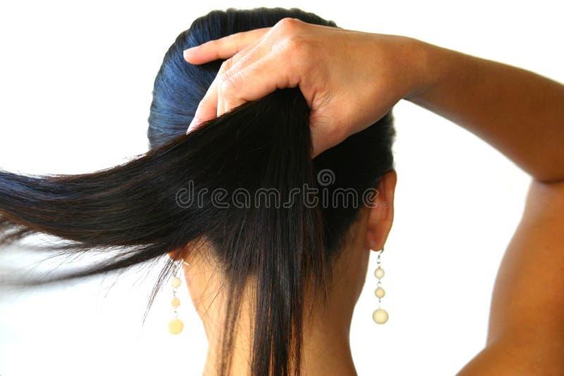 Pinsa e ponytail della mano fotografia stock