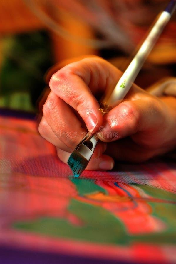 Pinsel in der Hand stockfotografie