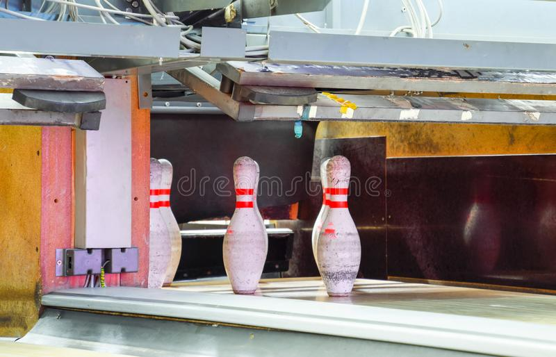 Pinsetter in the bowling alley. Pinsetter installed pins. A game. Of bowling stock photos