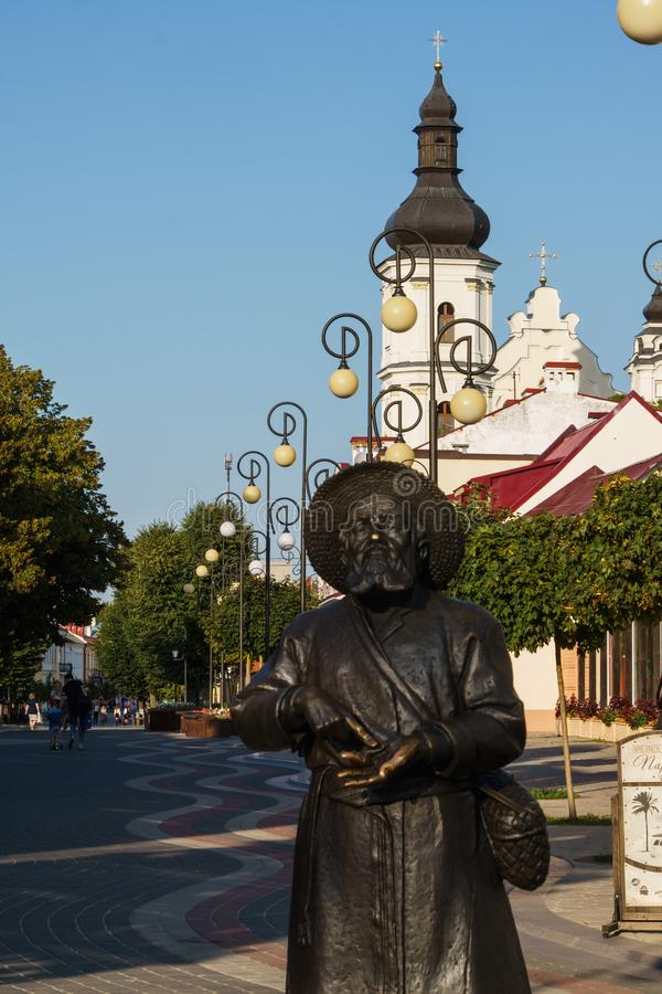 Pinsk, Belarus - August 26, 2019. Monument to the peasant. Pedestrian street and bell tower of the Assumption Cathedral of the. Blessed Virgin Mary stock photos