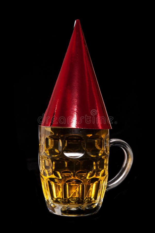 Pint of beer with birthday party hat. Cutout royalty free stock photography