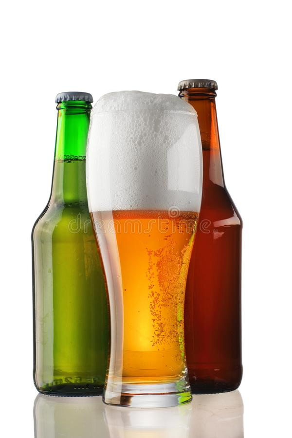 A pint of beer with two bottles royalty free stock image