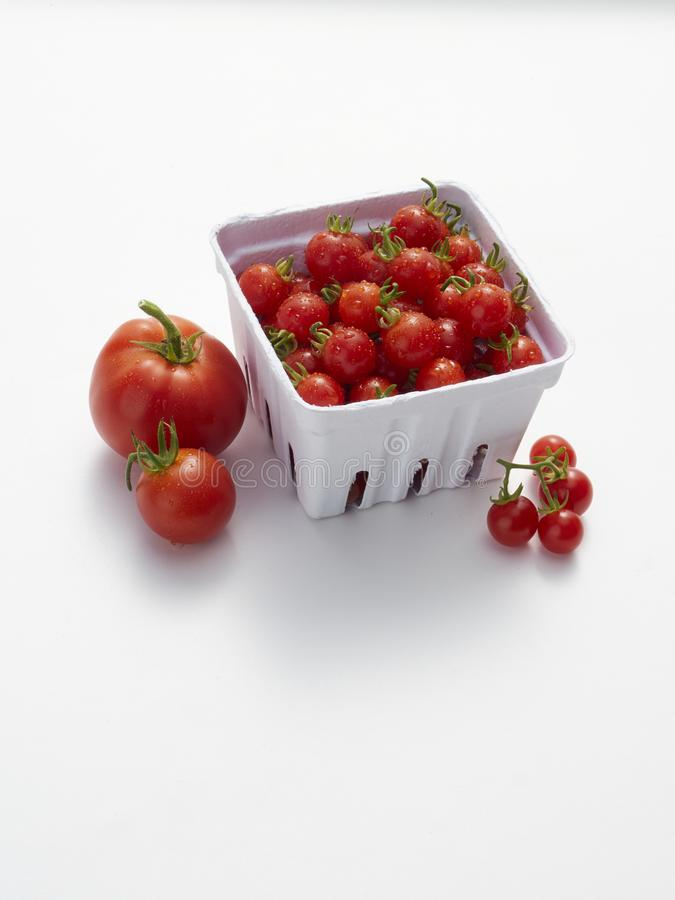 A pint of cherry tomatoes on white stock photo