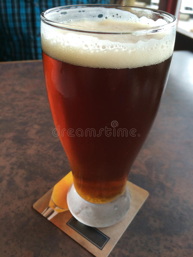 A pint of Indian Pale Ale Beer from the local brewery, Grandville Island, Vancouver, British Columbia, Canada. Grandville is a very nice place to hangout in stock photo