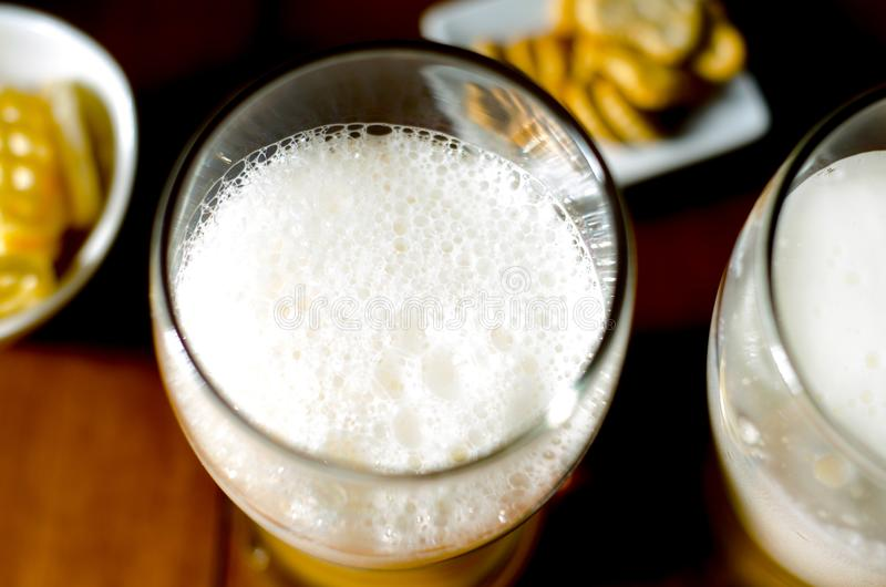 Pint of lager beer in a glass, set of various snacks, a standard stock photo