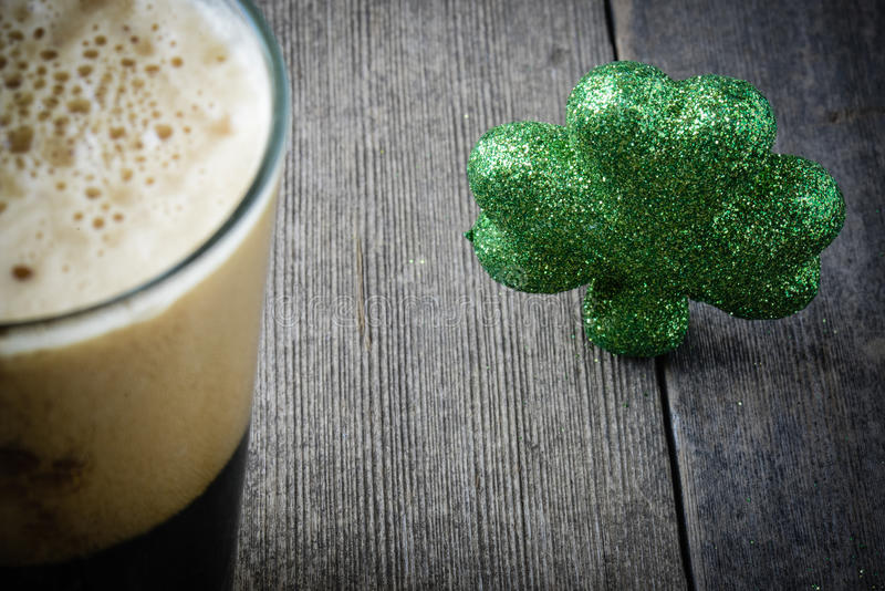 Pint of Stout Beer with Green Shamrock. For St. Patrick's Day stock photography