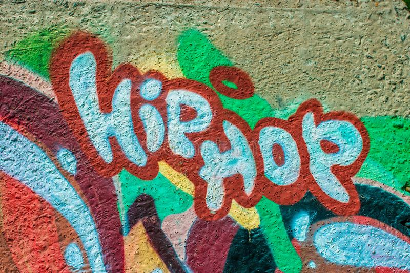 Pintada colorida en un muro de cemento stock de ilustración