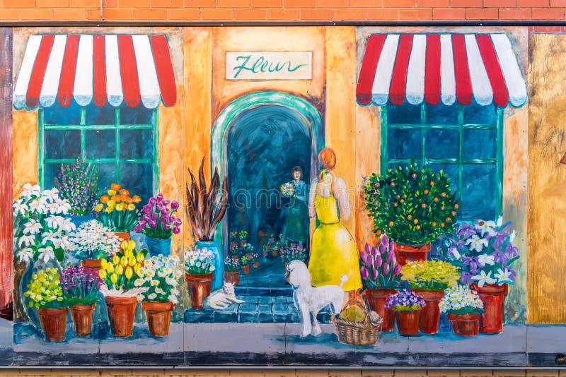 Pintada de la floristería foto de archivo